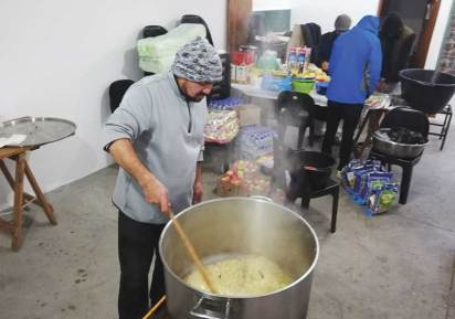 A volunteer serving lunch.