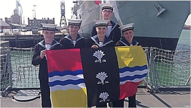 Sea Cadets holding the Bedfordshire Flag
