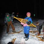 Visitors of all ages enjoy a snowshoeing event at WI Interstate Park