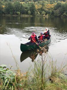 3 people canoeing