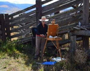 Painter Rita Roberts at work on location.- photo by David Montgomery