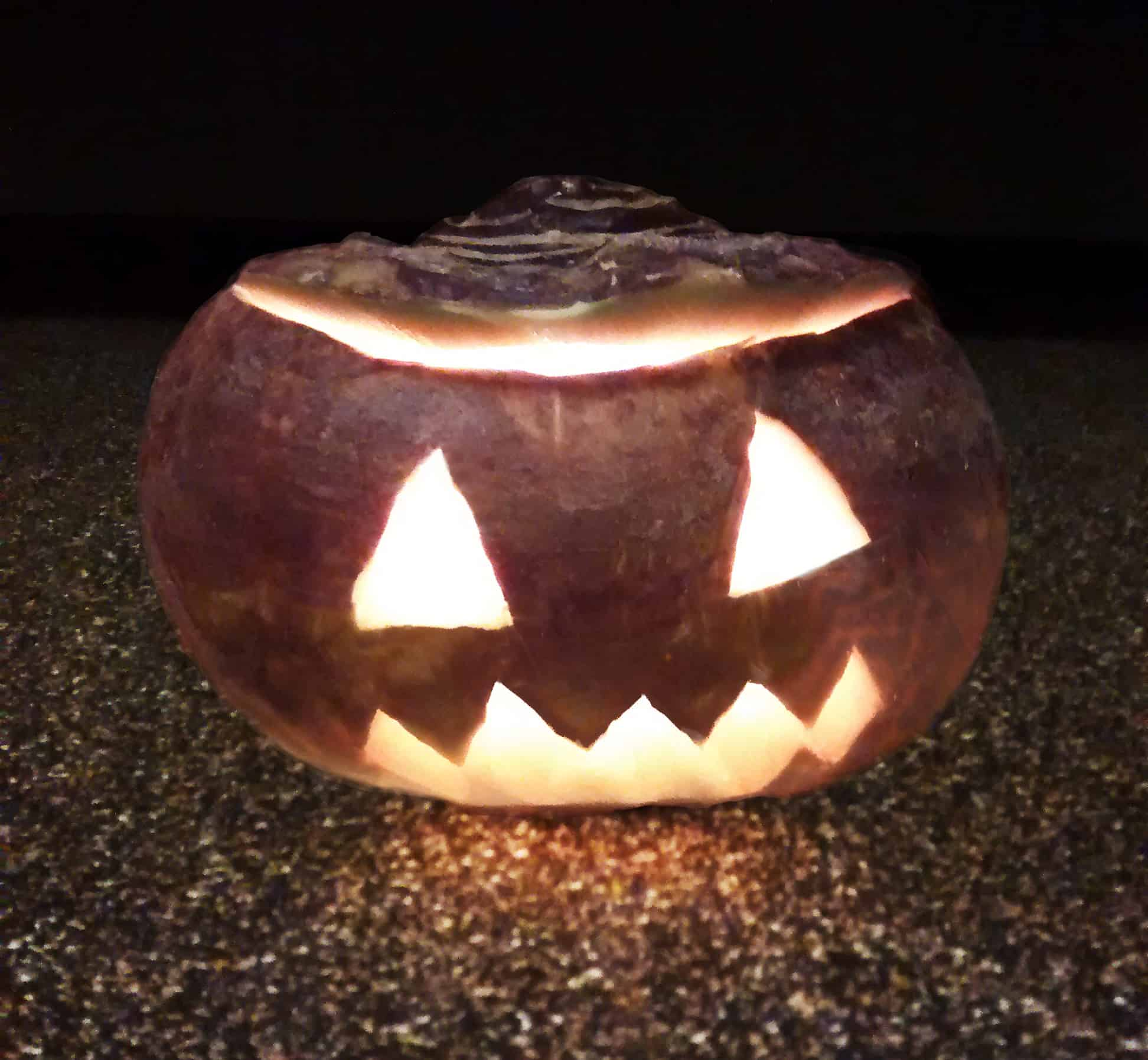 Halloween carved turnip lantern.