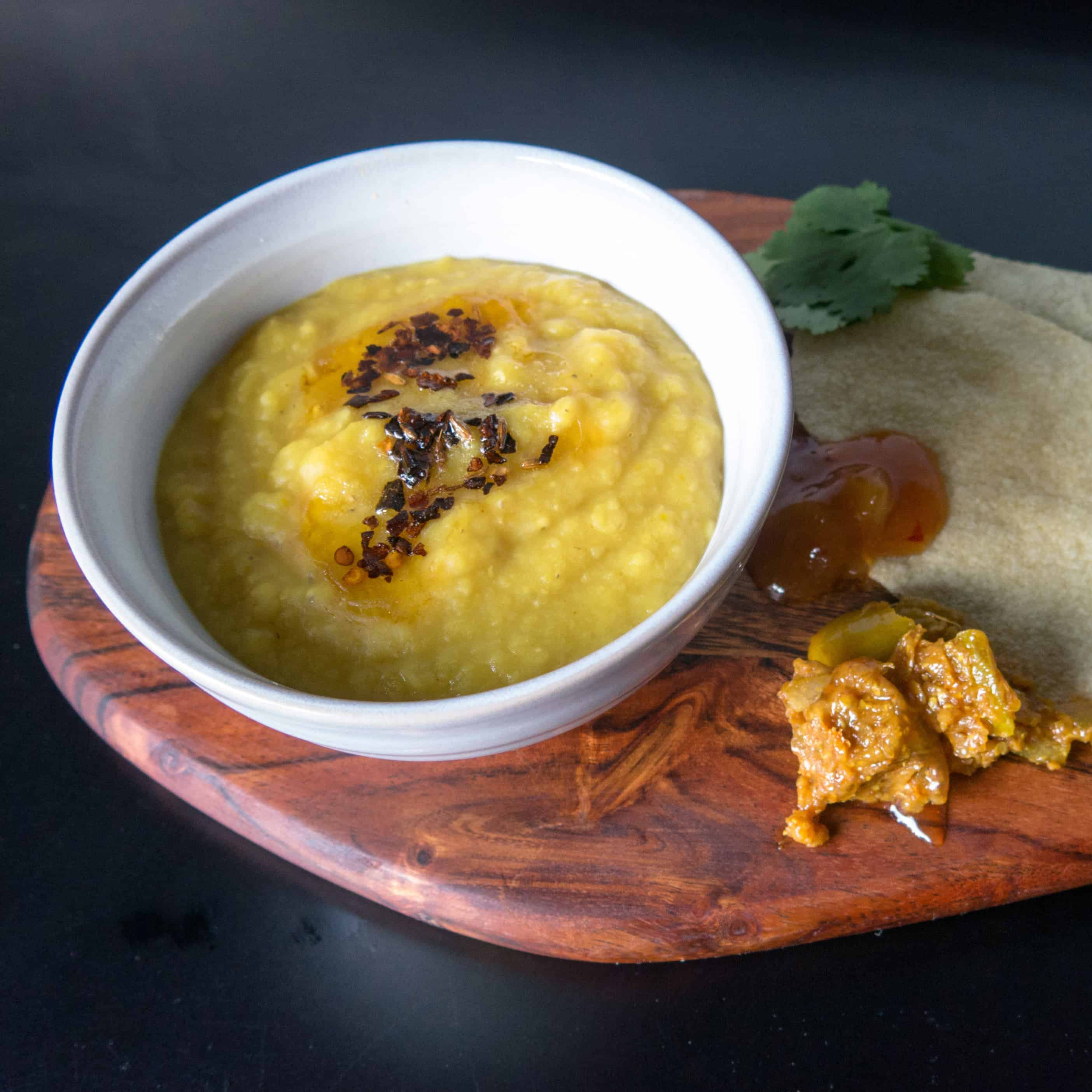 Lentil dahl. Gluten free, vegan, onion free, garlic free. Served with poppadoms and pickle