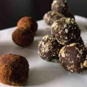 Gluten free, vegan chocolate orange truffles. Nut coated gluten free, vegan chocolate orange truffles