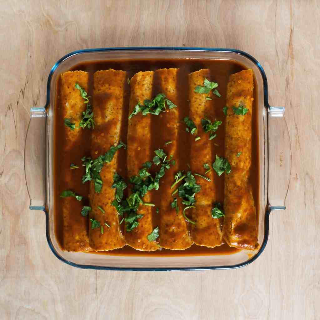 Gluten-Free, Vegan Black Bean and Kale Enchiladas. Ready to bake.