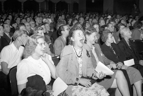 "8/14/1946, Berlin, Germany- A row of women laugh heartily as they see Charlie Chaplin's imitation of Hitler making a speech in the movie ""The Great Dictator."" Image by © Bettmann/CORBIS"