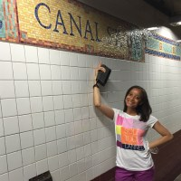 Me pointing to the Canal St. Metro Sign in NYC