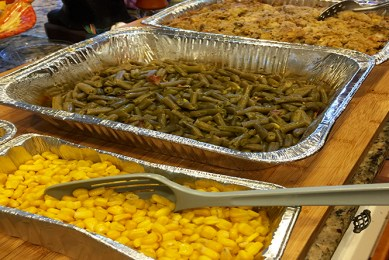 Pans of corn, green beans, and stuffing.