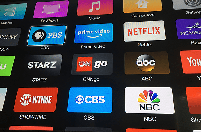 Photo of a flat-panel tv displaying Apply TV apps.