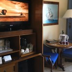 Photo of a tv console and side table with chairs.