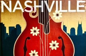 """Picture of the words """"NASHVILLE"""" sitting on top of a floral red guitar in from of a Nashville skyline silhouette."""