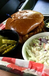 Chicken sandwich, pickles, and cole slaw.