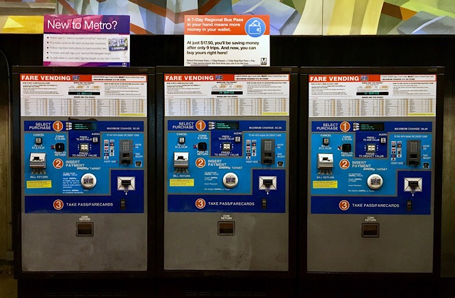 Photo of three fare vending machines.