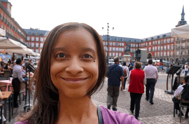 Selfie photo of Antoinette standing in Plaza Mayor in Madrid, Spain. Frolic & Courage.