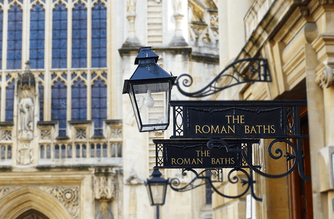 Photo of the entrance sign to the ancient Roman Baths in Bath, England