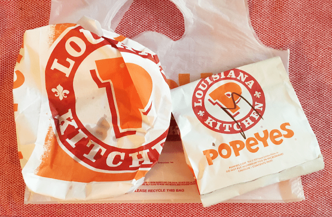 Photo of Popeyes chicken sandwich meal packaging.