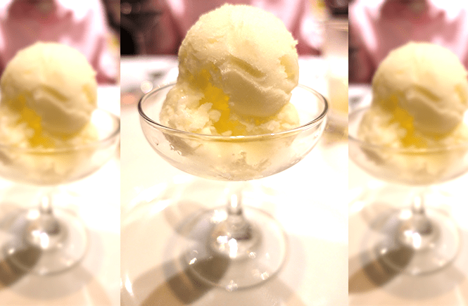 Photo of a glass of lemon sorbet from Chops Grille on Royal Caribbean Enchantment of the Seas