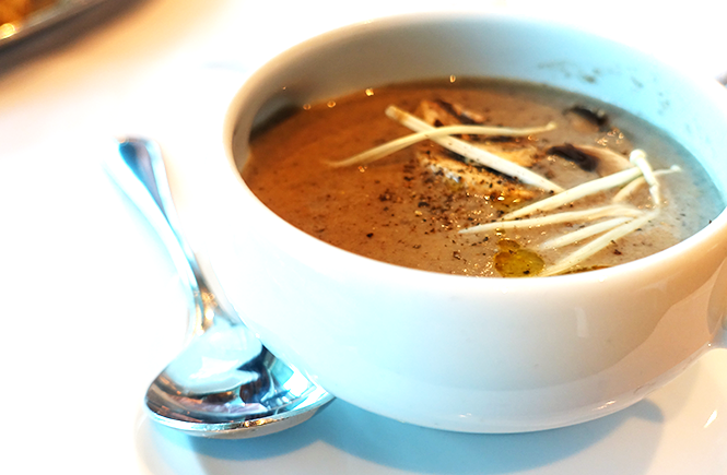 Photo of a bowl of forest mushroom soup from Chops Grille on Royal Caribbean Enchantment of the Seas cruise ship by Frolic & Courage.