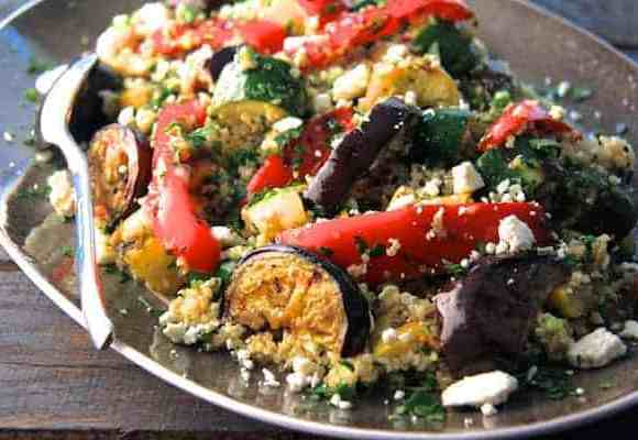 Mediterranean Quinoa and Grilled Vegetable Salad close-up shot on platter with gray border