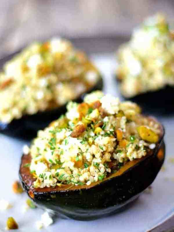 Quinoa, Feta and Pistachio-Stuffed Acorn Squash - Hero shot of squash on white serving platter