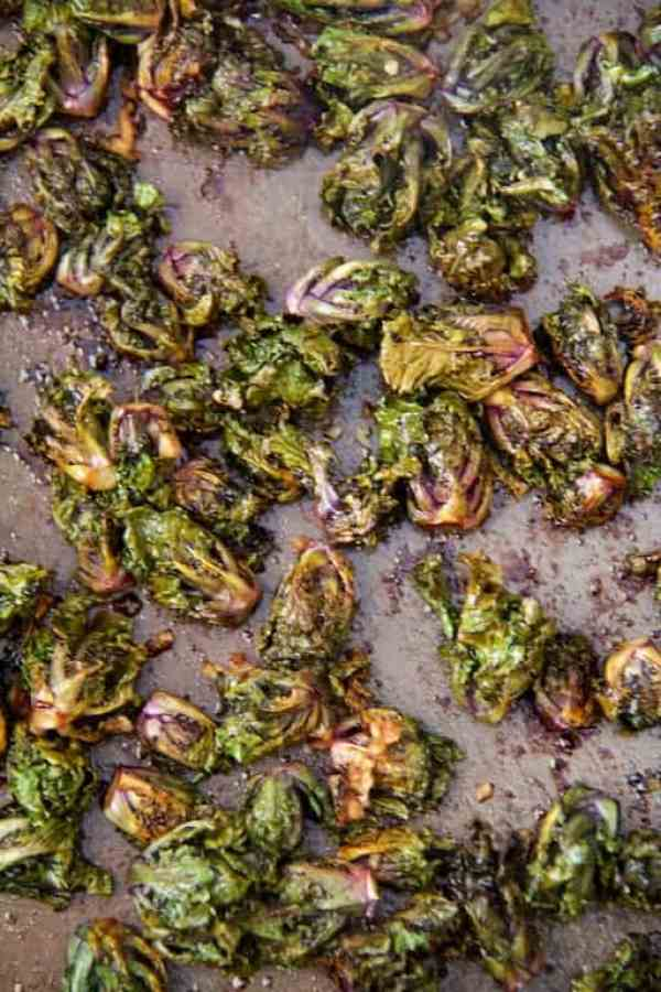 Balsamic Roasted Kale Sprouts with Shaved Parmesan - Overhead shot of roasted kale sprouts on baking sheet