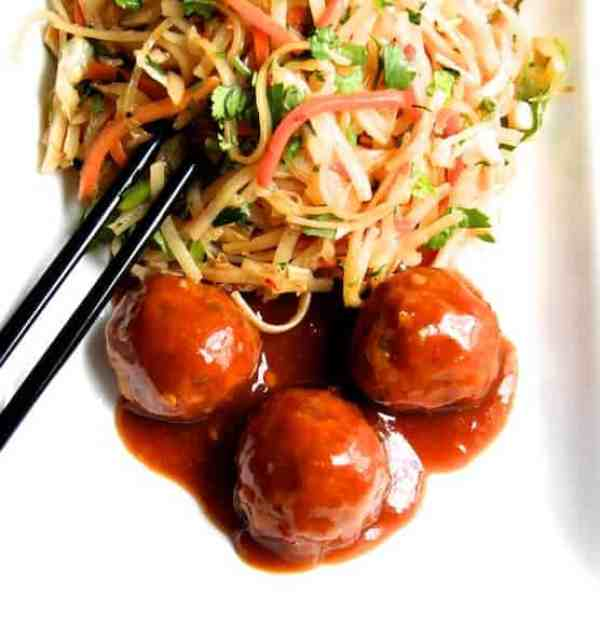 Hoisin Glazed Pork Meatballs and Rice Noodles with Cabbage and Carrots - Overhead shot of dish on white plate with black chopsticks