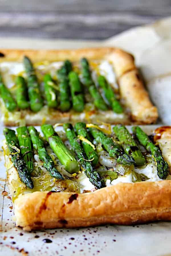 Asparagus, Spring Onion and Fontina Tart - Tart cut into quarters ready to be served