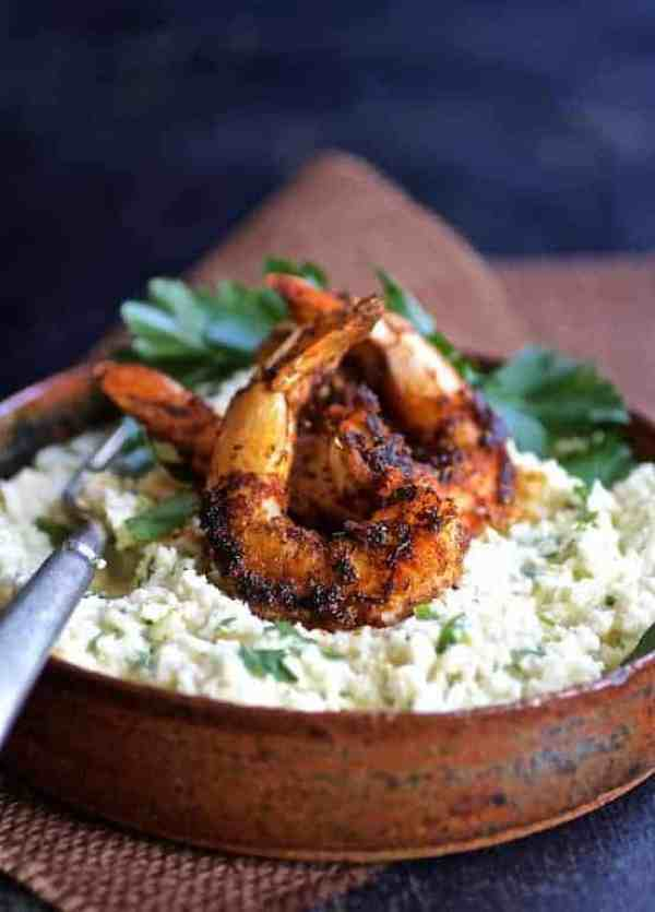 Cauliflower Grits with Gouda Cheese and Blackened Shrimp - Hero shot in clay dish on blue background