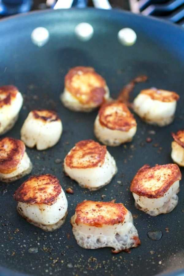 Nicely browned sea scallops in nonstick skillet
