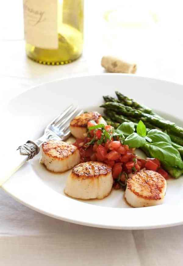 Seared Sea Scallops with Tomato, Red Onion and Balsamic Salsa - Hero shot of dish on white plate