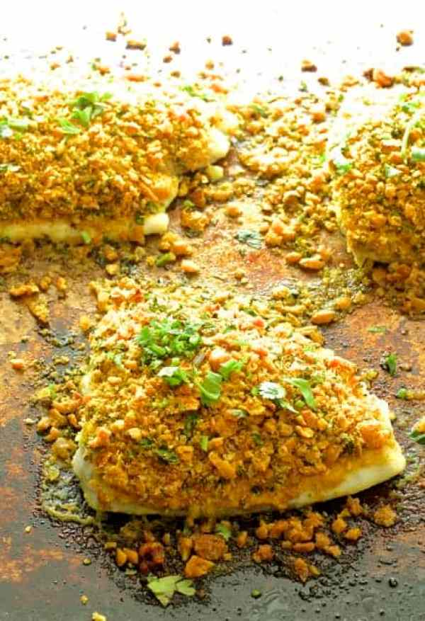 Curried Chickpea Encrusted Fish with Jalapeno Lime Tartar Sauce - Close-up shot of fish on baking sheet