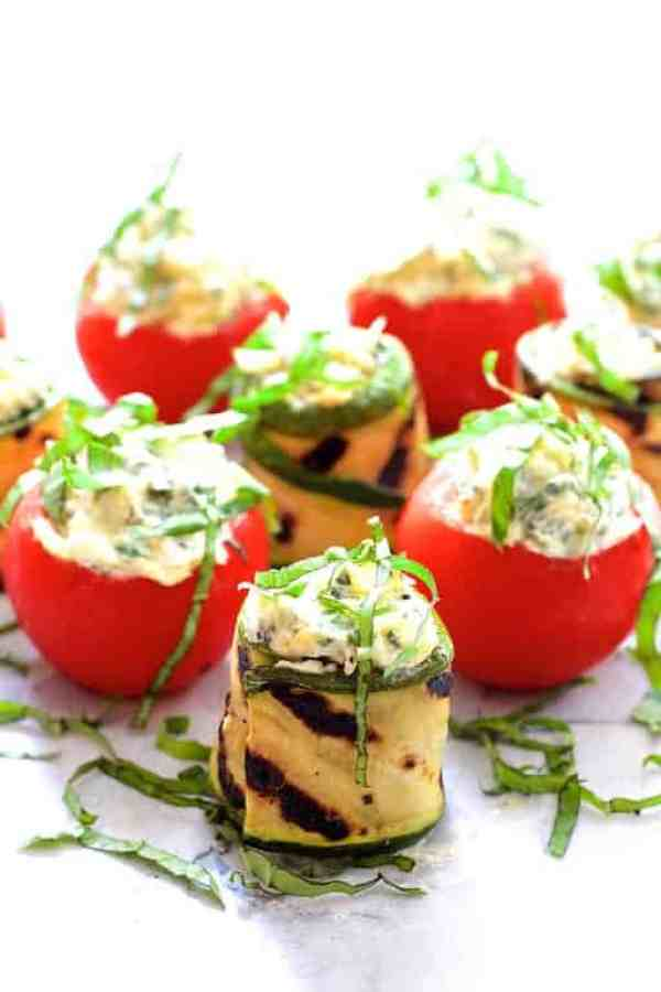 Cheese and Artichoke Stuffed Tomatoes and Grilled Zucchini - Close-up hero shot garnished with thinly sliced basil