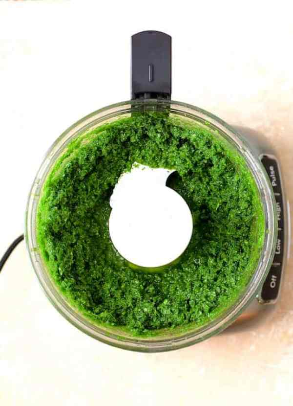 Radish Greens Pesto - Overhead shot of pesto in food processor.