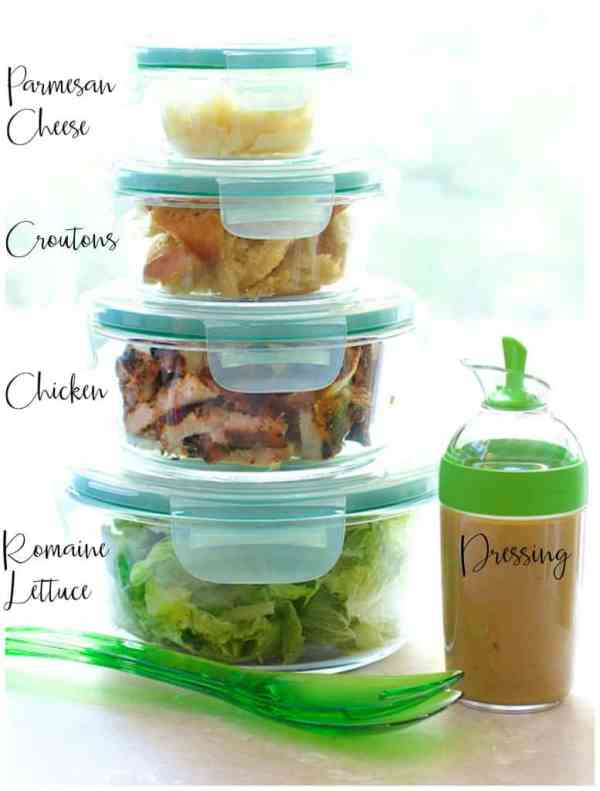 Components of Blackened Chicken Caesar Salad with Sourdough Croutons stacked in glass containers