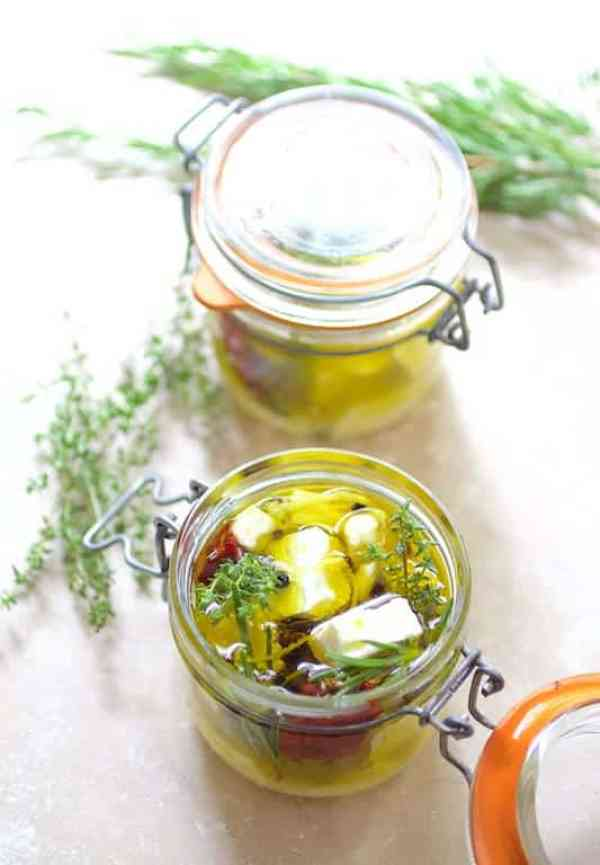 Marinated feta cheese in glass jars