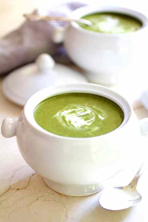 Cream of Green Vegetable Soup - Hero shot in white bowl on marble surface with cream swirled in