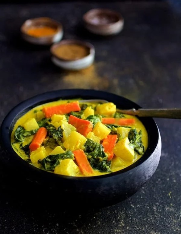 Indian Root Vegetable Curry - Another view of dish in black bowl
