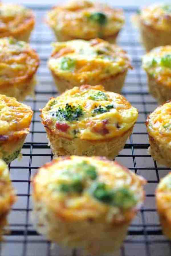 Spaghetti Squash Broccoli Bacon and Cheddar Mini Quiches - Hero shot of quiches on cooking rack after being removed from muffin pan