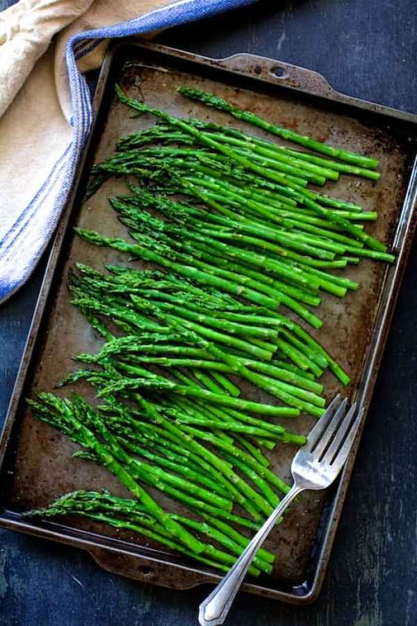 Overhead shot of finished asparagus on baking sheet