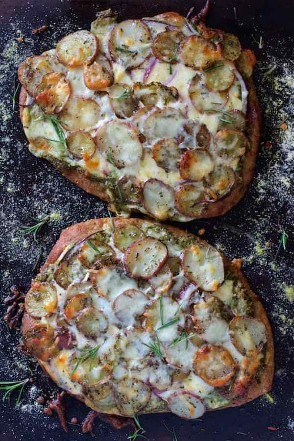 Baked Naan Potato Pizza with Radish Pesto and Smoked Mozzarella before being cut.