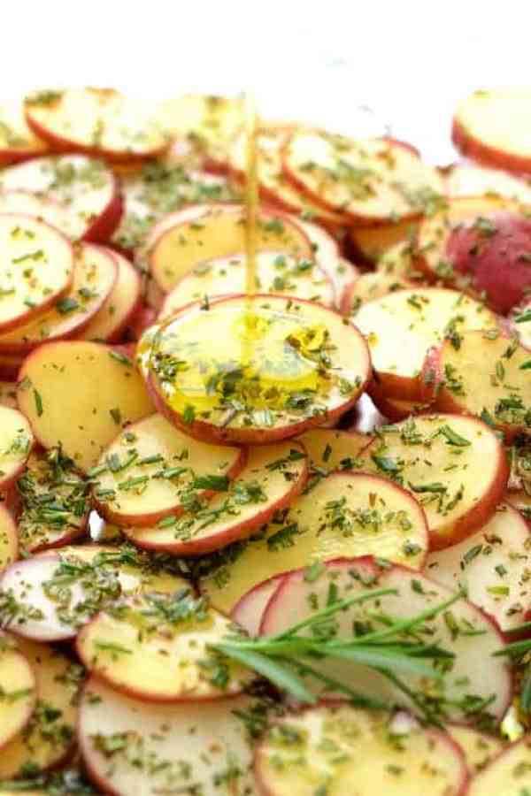 Thinly sliced red potatoes, rosemary and olive oil for Naan Potato Pizza with Radish Pesto and Smoked Mozzarella