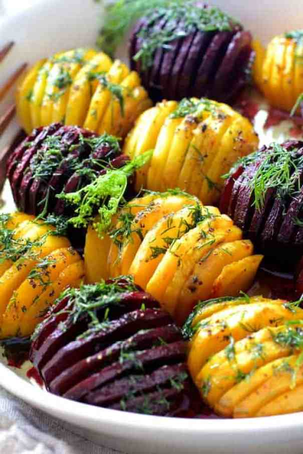 Roasted Hasselback Beets with Dill Dressing - Close-up shot of roasted beets in white serving dish garnished with fresh dill