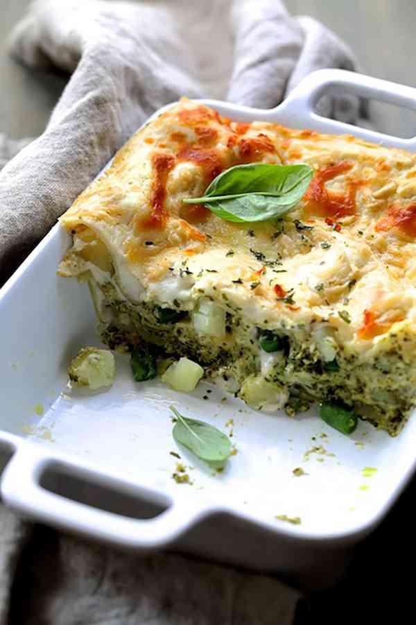 Lasagna with Pesto Green Beans and Potatoes - Pan of lasagna cut into showing the layers of pasta, potatoes ad green beans