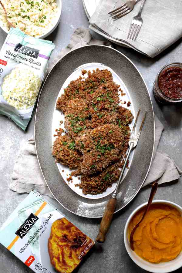 Pecan Crusted Turkey Cutlets with Red Onion Marmalade and Alexia Sides - Overhead shot of everything on gray background