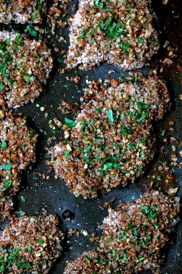 Pecan Crusted Turkey Cutlets with Red Onion Marmalade and Alexia Sides - Top Down Shot of Pecan Crusted Turkey Cutlets on baking sheet sprinkled with parsley