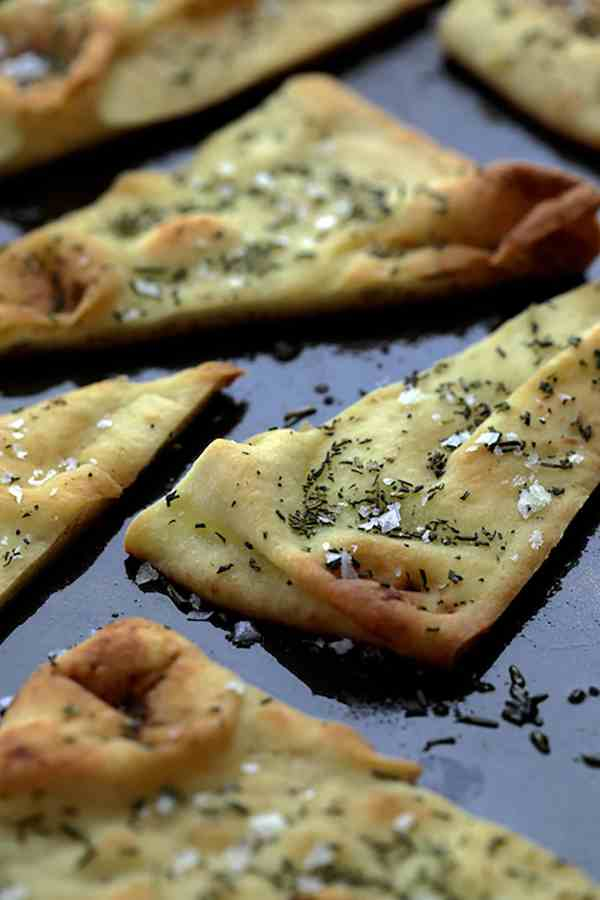 White Bean Artichoke Spread with Rosemary Sea Salt Flatbread Chips - Close-up photo showing baked flatbread chips