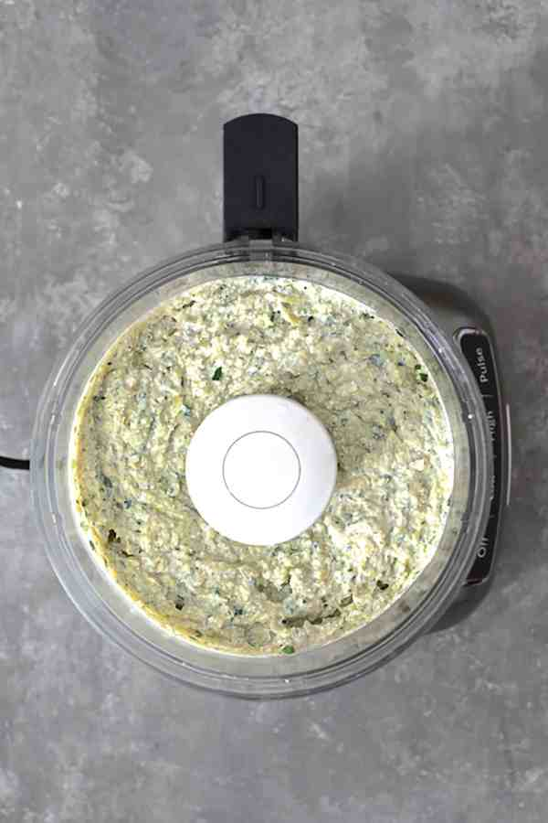 White Bean Artichoke Spread with Rosemary Sea Salt Flatbread Chips - Overhead shot of blended spread in food processor