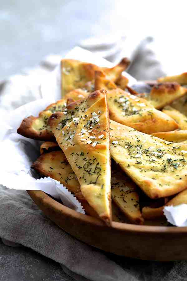White Bean Artichoke Spread with Rosemary Sea Salt Flatbread Chips - Photo showing basket of baked flatbread chips