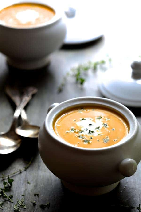 Butternut Squash Soup with Thyme and Taleggio - Photo of soup on gray surface in white bowls with spoons