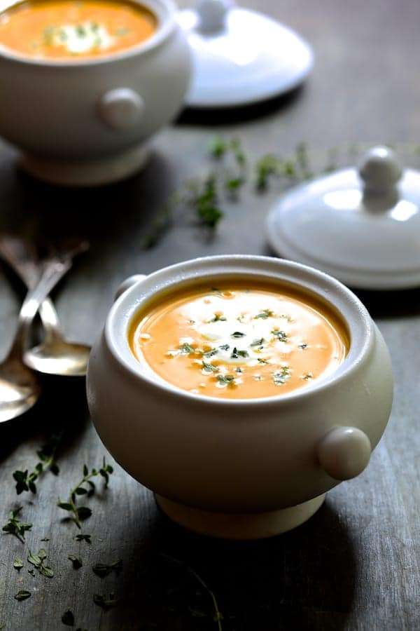 Butternut Squash Soup with Thyme and Taleggio - Soup in white bowl garnished with thyme
